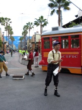 "Red Car Newsboys is… ""fine."" The same things I said about Mickey and the Magical Map generally apply here. It's largely inoffensive, but not terribly good. I can't resent it because it's live entertainment and that in-and-of-itself adds value, but I can still wish it was better than it is."