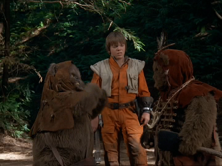 Mace sneers at a pair of Ewoks.