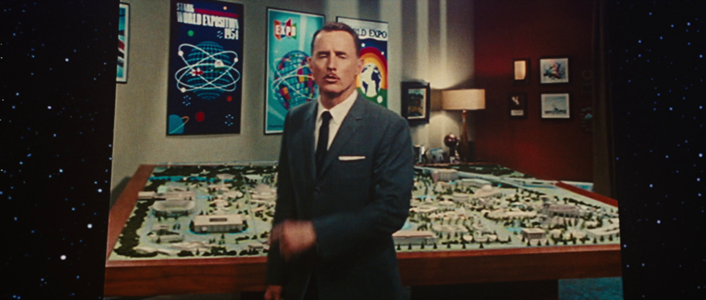 Archival footage of Howard Stark standing in from of a poster for the Stark World Exposition 1954.