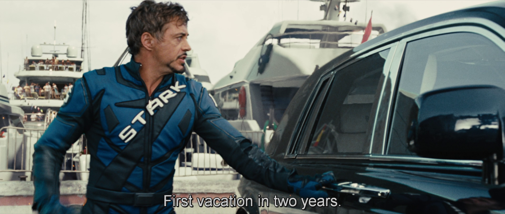 """Tony getting into a car after being attacked by Whiplash, complaining that this was his """"First vacation in two years."""""""