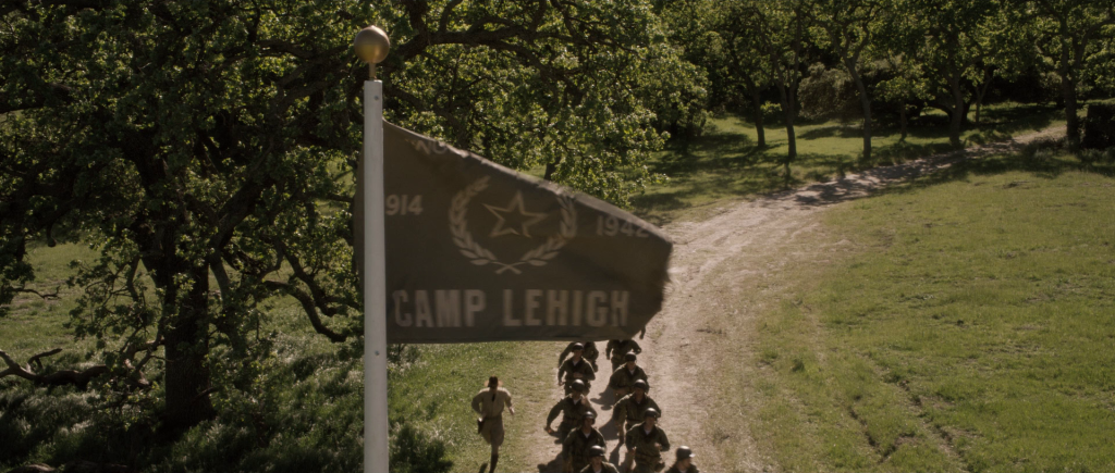 Flag at Camp Lehigh emblazoned with the years 1914 and 1942.
