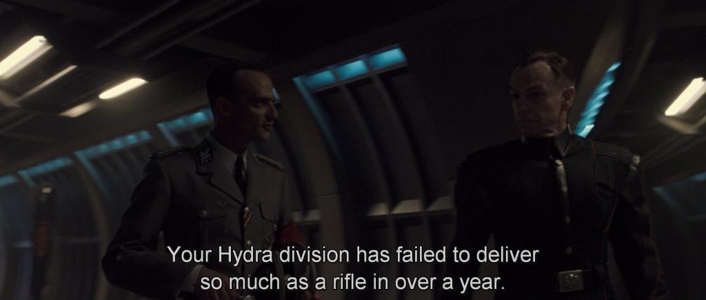 Nazi military leaders questioning Johann Schmidt on his progress,